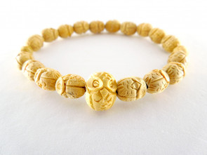 Boxwood bracelet with owls carved